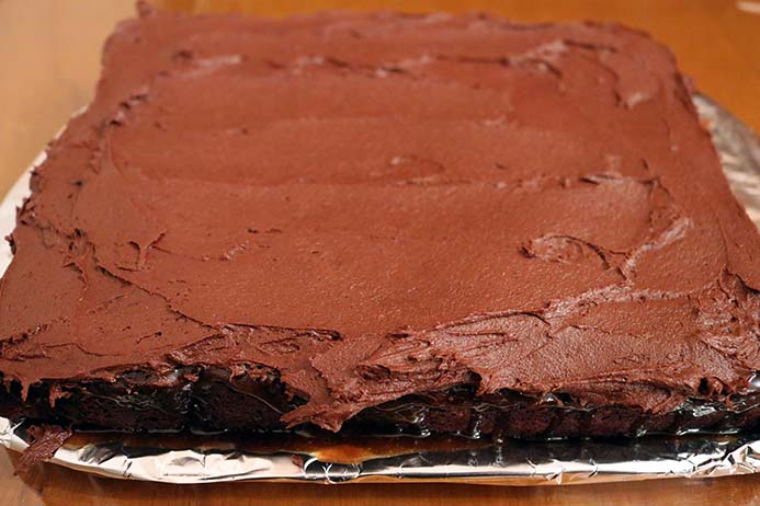 Chocolate cake covered with chocolate frosting