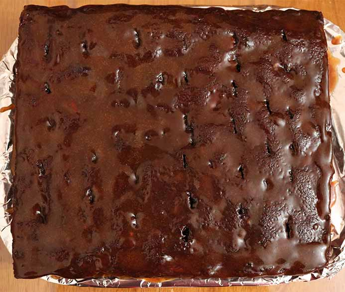 The chocolate cake with holes poked in it topped with the salted caramel sauce