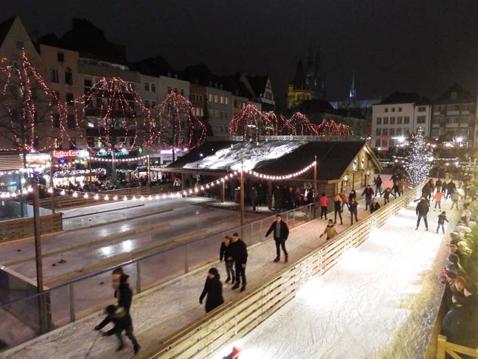 Cologne Christmas Markets Guide Old Christmas market in Cologne Germany ice-rink and ice skaters