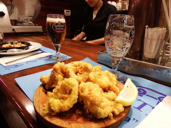 La Boqueria Food Market in Barcelona tapas of calamari