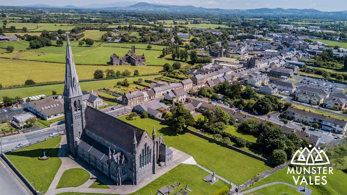 Munster Vales Ireland Travel Guide. Aerial photograph of Munster Vales and the green fields and local towns.
