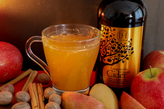 Hot Apple Cider recipe made with Longueville Beverages Cider and mulled with cinnamon, cloves and orange and spiked with Longueville House Apple Brandy for an adult cider punch.