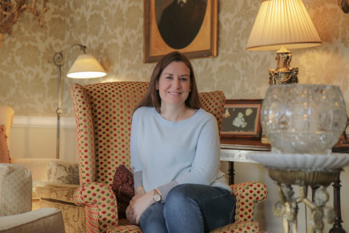 Longueville House Cork review - this is a stunning four-star heritage-listed Georgian property in Mallow Co. Cork in Ireland. This is Melanie May relaxing in the sumptuous in the lounge.