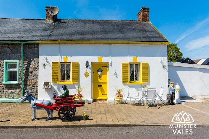 Munster Vales Ireland Travel Guide. Photograph of traditional Irish cottage.