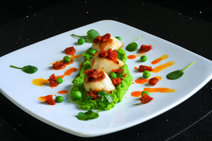 Seared scallops with chorizo and pea purée recipe.