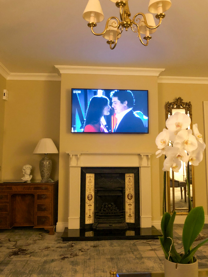 Big TV screen above the fire place in Glenlo Abbey Hotel