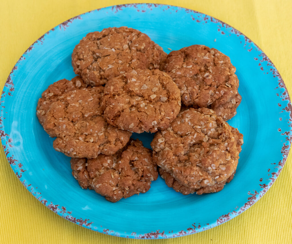 ANZAC Biscuits on a blue plate