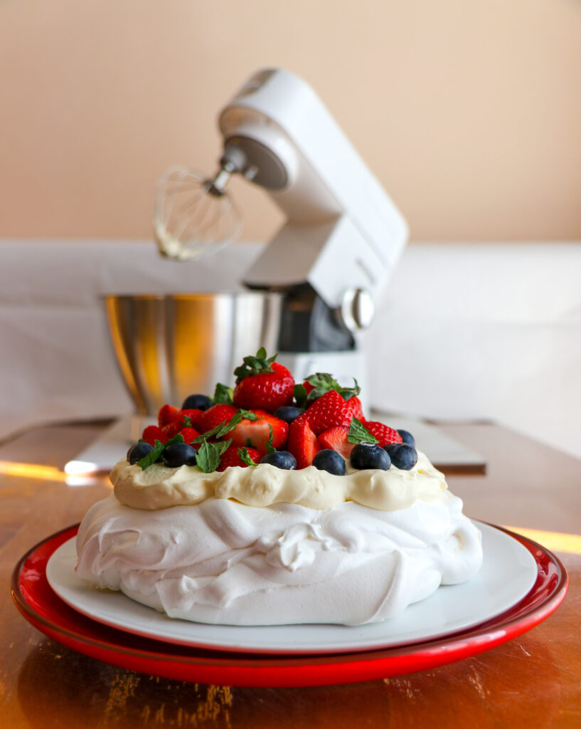 Summer berry pavlova recipe and food photography by Melanie May