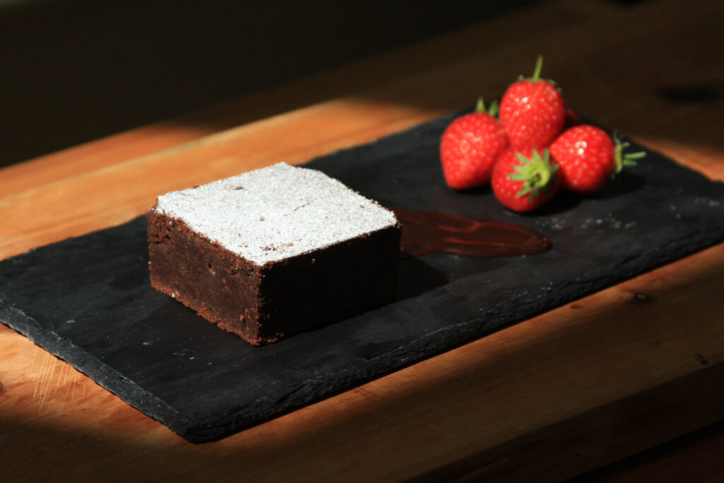 Dark cake with strawberries- food photography and styling by Melanie May