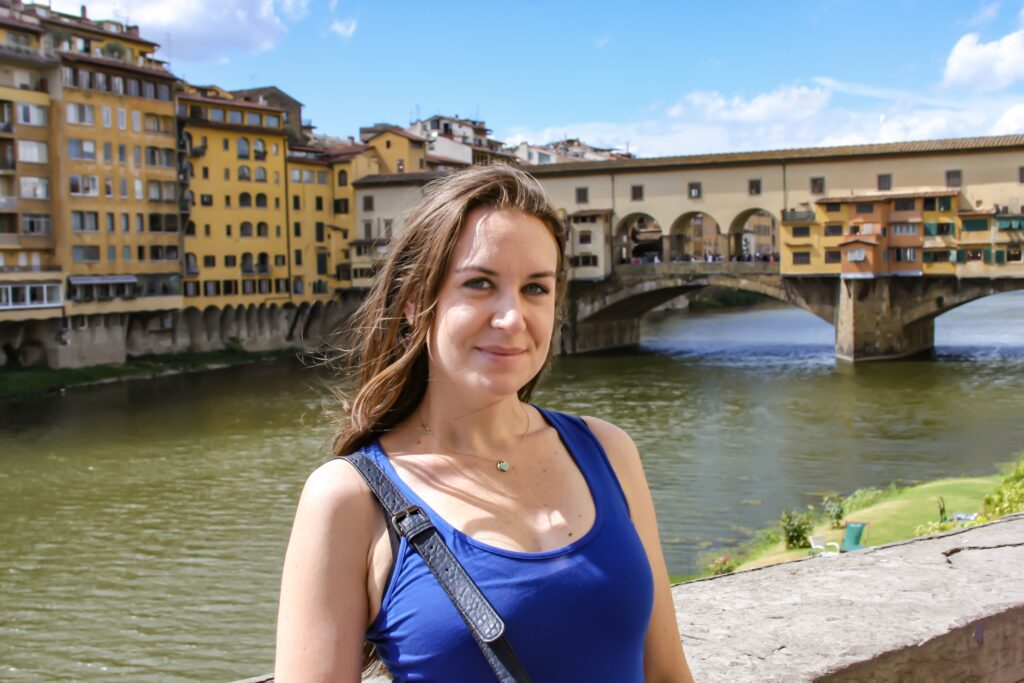 Melanie May Content Creator by a bridge in Florence, Italy. melanie may travel journalist